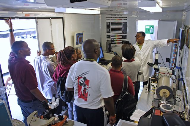 Students and parents attend a demo inside NNIN and Howard University's mobile educational project, the NanoExpress